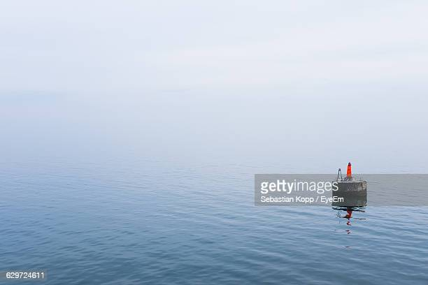 Distance Marker In Baltic Sea Under Foggy Weather