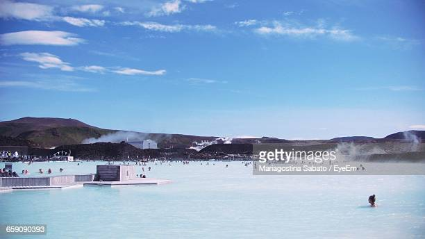 Distance Shot Of People Bathing In The Blue Lagoon
