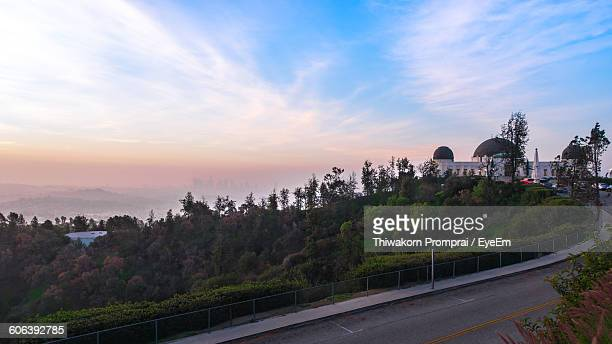 Distance View Of Griffith Park Observatory Against Sky During Sunset