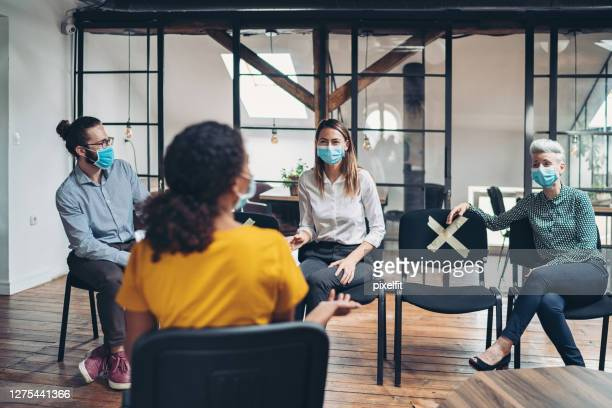 distancing during a business meeting - small group of people stock pictures, royalty-free photos & images