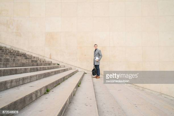 Distant businessman against wall