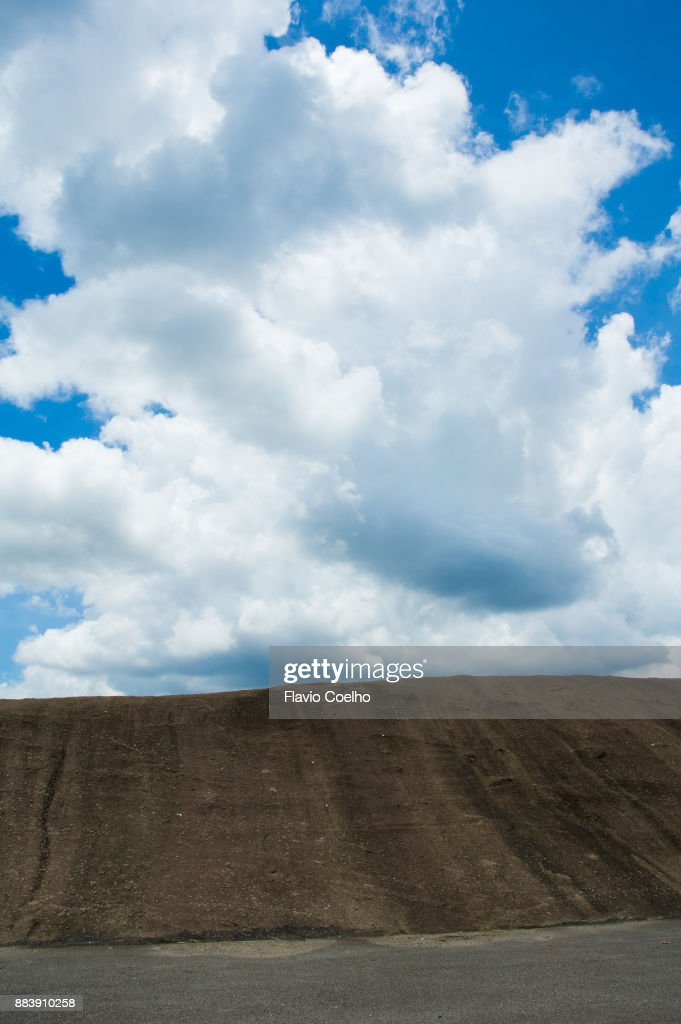 Distant clouds with rock formation on the foreground : Stock Photo