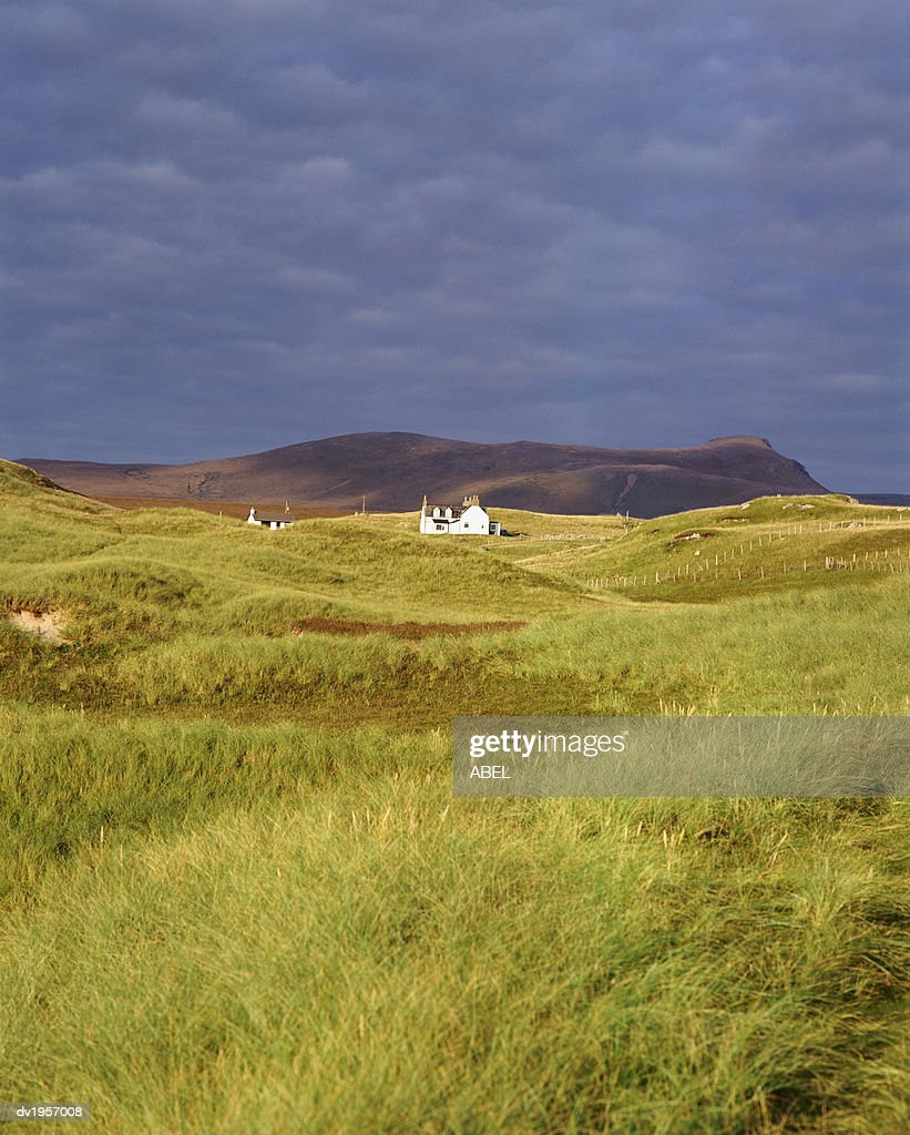 Distant Cottage in Oldshoremore, Sutherland, Scotland : Stock Photo