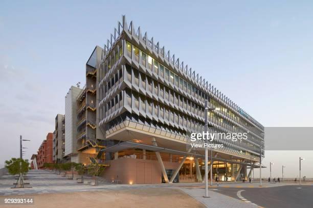 Distant elevation at dusk. Siemens Masdar, Abu Dhabi, United Arab Emirates. Architect: Sheppard Robson, 2014.