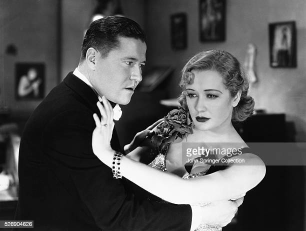 A distant Gloria Bishop pulls away from Duke Taylor in a scene from the 1932 drama Dancers in the Dark