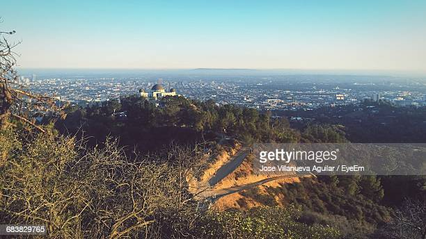 distant image of griffith observatory against clear sky - griffith park stock pictures, royalty-free photos & images