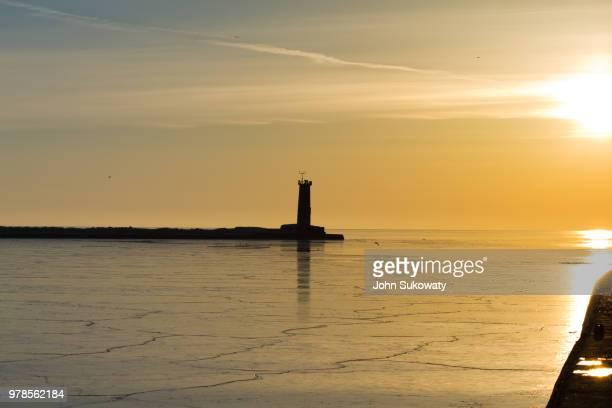 Distant lighthouse at sunset, Sheboygan, Wisconsin, USA