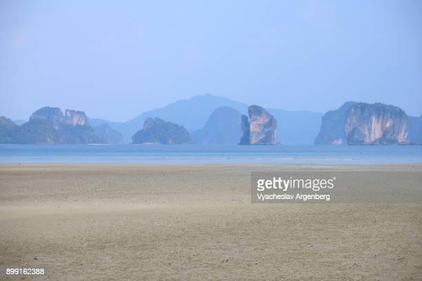 Distant limestone islands of Phang Nga bay as seen from Koh Yao Noi island, Thailand