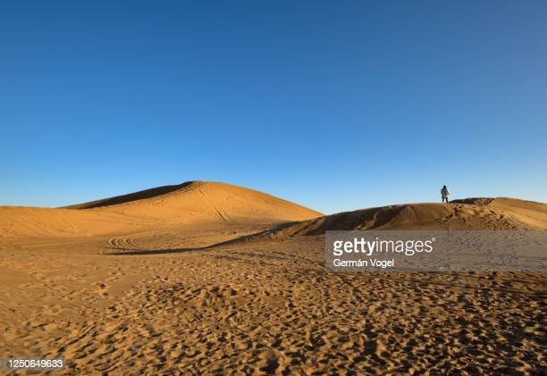 distant lone person walking among desert dunes, shabahang, yazd, iran - footprint stock pictures, royalty-free photos & images