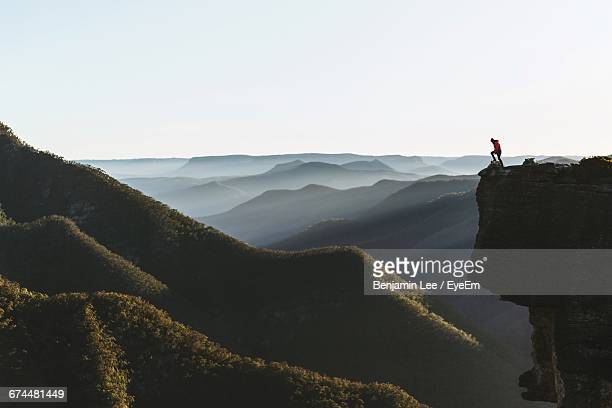 distant person on top of a mountain - paesaggio spettacolare foto e immagini stock