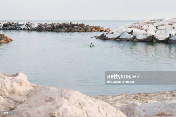 distant scuba diver in the sea