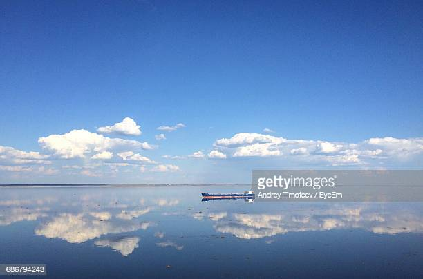 distant ship sailing on volga river - volga stock pictures, royalty-free photos & images