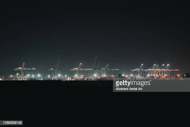 distant shot of london gateway port at night, england, united kingdom - harbour stock pictures, royalty-free photos & images