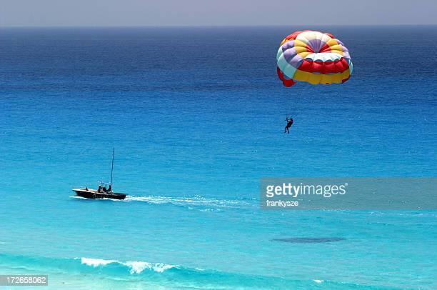 Distant shot of parasailing over ocean