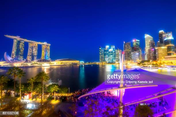 distant view around the marina bay during the twilight time. - copyright by siripong kaewla iad ストックフォトと画像