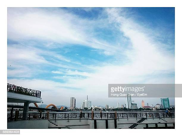 distant view of cityscape against cloudy sky - hong quan stock pictures, royalty-free photos & images