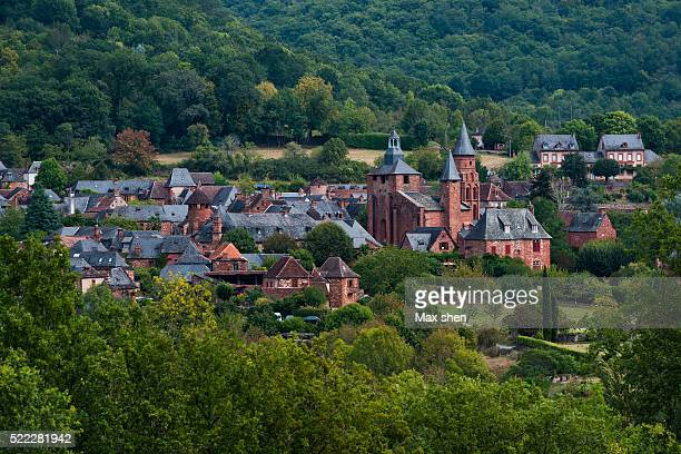 distant view of collonges-la-rouge in france. - correze stock pictures, royalty-free photos & images