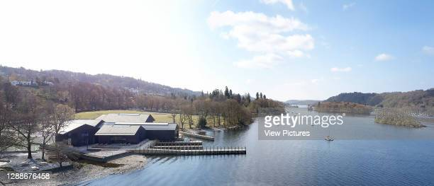 Distant view of exterior facade with view of Lake Windermere. Windermere Jetty Museum, Windermere, United Kingdom. Architect: Carmody Groarke, 2019.