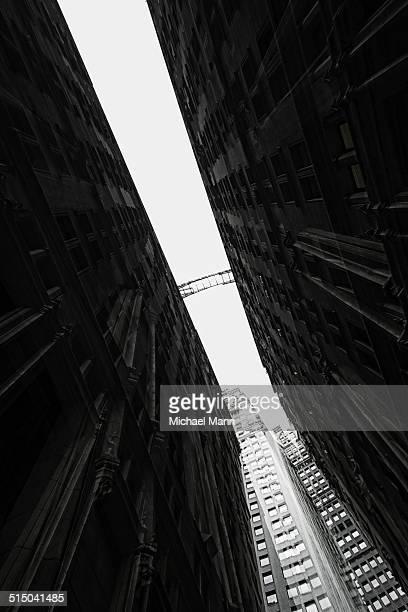 Distant view of footbridge between two building facades in Financial district, Manhattan, USA