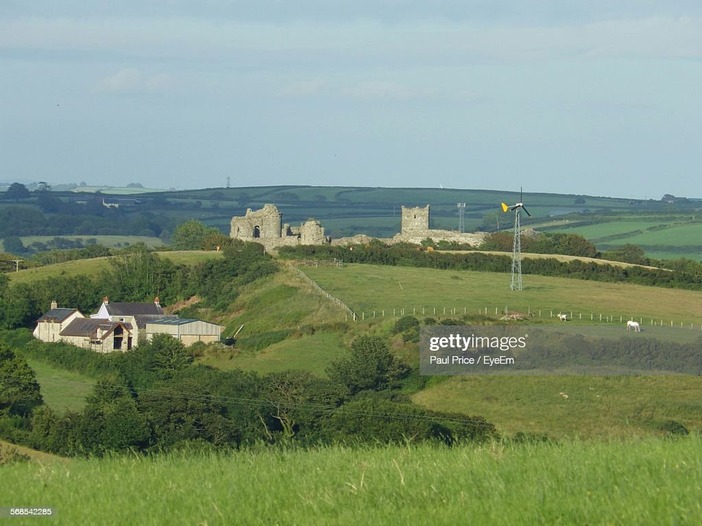 Distant View Of Fort On Grassy Field Against Sky : Stock Photo