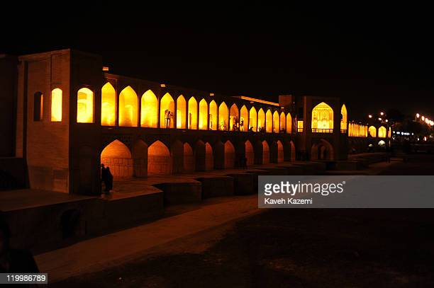 Distant view of Khaju Bridge at night. Khaju Bridge is arguably the finest bridge in the province of Isfahan, Iran. It was built by the Persian...