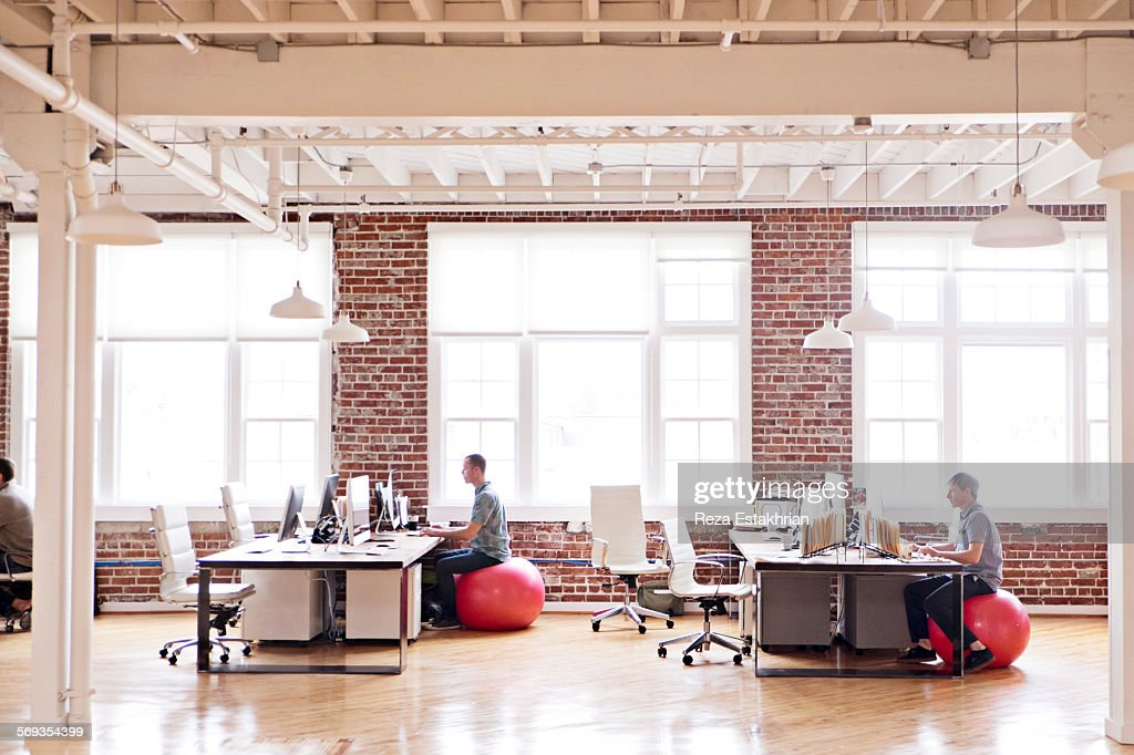 Distant view of open plan office : Stock Photo