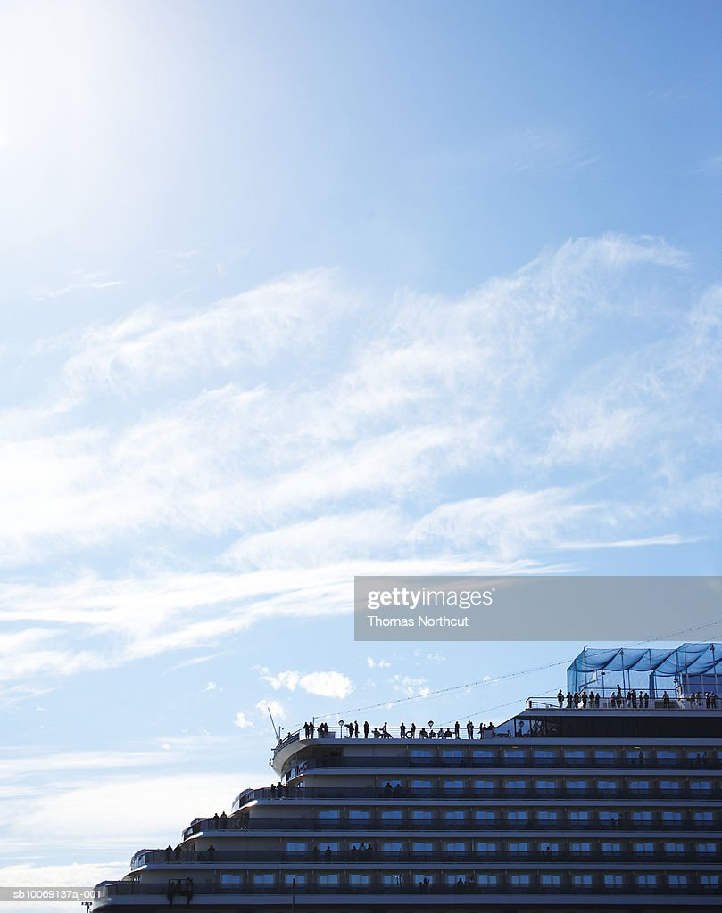 Distant view of people on ferry deck : Stockfoto