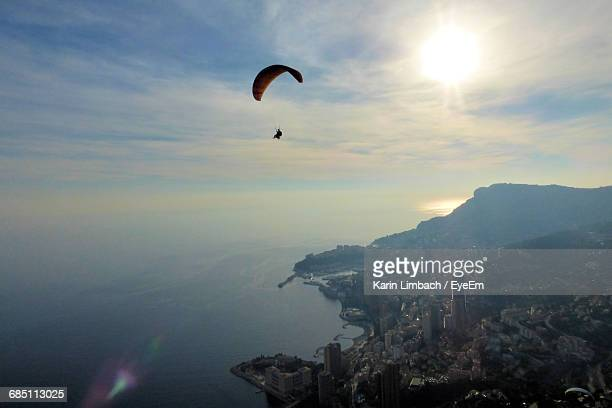 Distant View Of Person Paragliding Against Sky