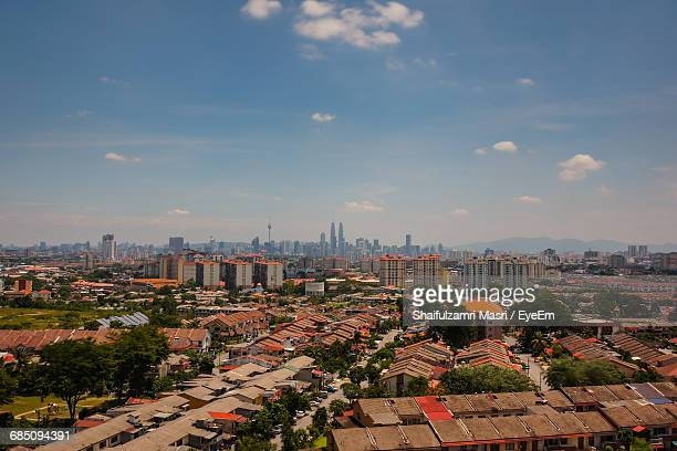 distant view of petronas towers and kuala lumpur tower in city against sky - shaifulzamri eyeem stock pictures, royalty-free photos & images