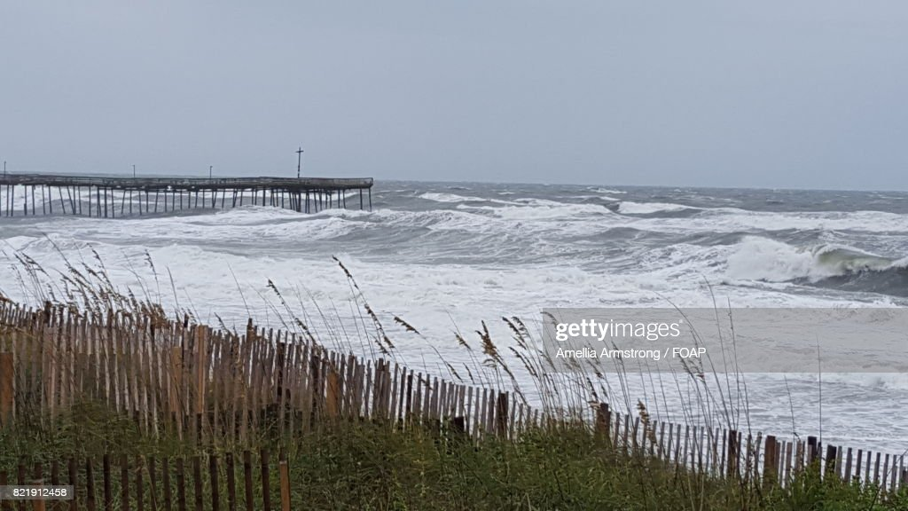 Distant view of pier in sea : Stock Photo