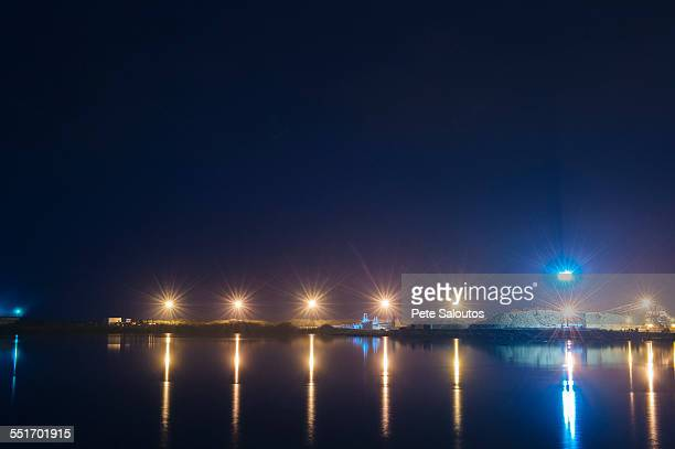 Distant view of pulp mill on waterfront at night, Strait of Juan de Fuca, Port Angeles, Washington State, USA