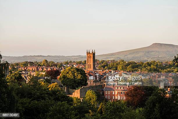 distant view of st laurence church in town against clear sky - ludlow shropshire stock photos and pictures