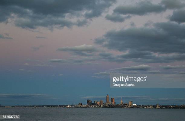distant view of the colorful sky above lake erie and cleveland city - rock and roll hall of fame cleveland stock pictures, royalty-free photos & images