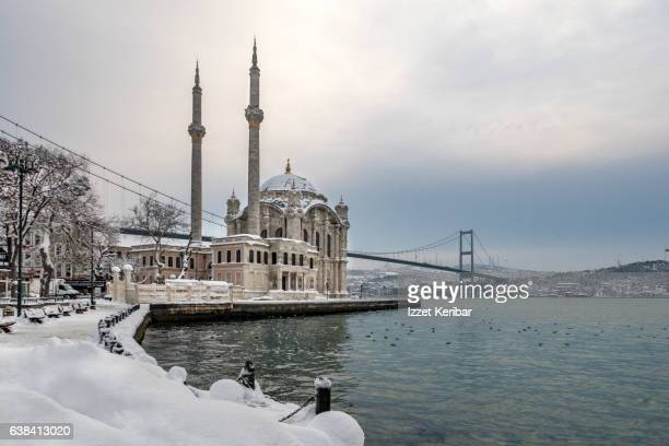Distant view of the Ortakoy Mosque on a snowy day Ortakoy - Istanbul Turkey