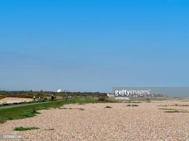 distant view of thorpeness and sizewell from aldeburgh, suffolk - aldeburgh stock photos and pictures