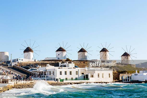 Distant view of traditional windmills on Mykonos island, Cyclades, Greece