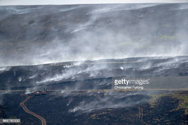 A distant view of Winter Hill near Bolton shows the massive task firefighters are facing to control hundreds of smouldering embers on July 2 2018 in...