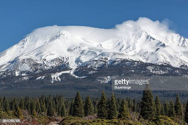 Distant views of looming Mount Shasta located at the southern end of the Cascade Range in Siskiyou County California