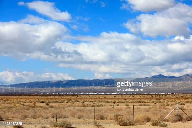distant wind farm and air force base tecachapi pass california - military base stock pictures, royalty-free photos & images