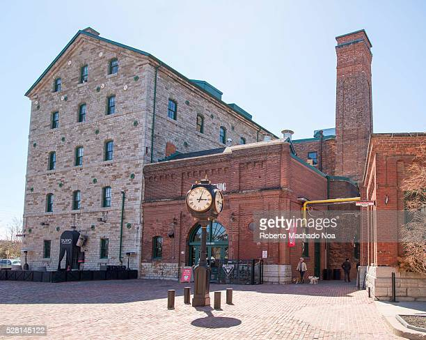 Distillery district Colonial buildings behind vintage black street clock with Roman numerals The location is a heritage site and major tourist...