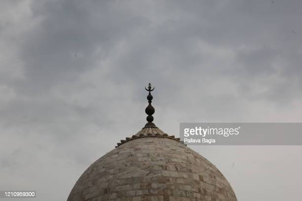 Distinct yellowing seen on the marble at the Taj Mahal. On February 28, 2020 in Agra, India. The Taj Mahal after years of tourism and air pollution...