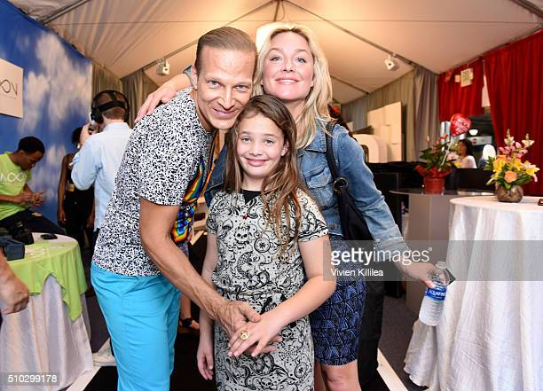 Distinctive Assets founder Lash Fary actress Elisabeth Rohm and Easton August Anthony Wooster attend the GRAMMY Gift Lounge during The 58th GRAMMY...