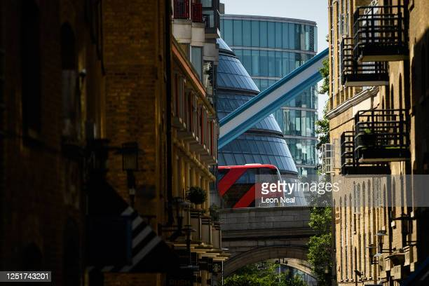 Distinctive curved line of the current City Hall building is seen between the buildings of Shad Thames on June 24, 2020 in London, England. Mayor of...