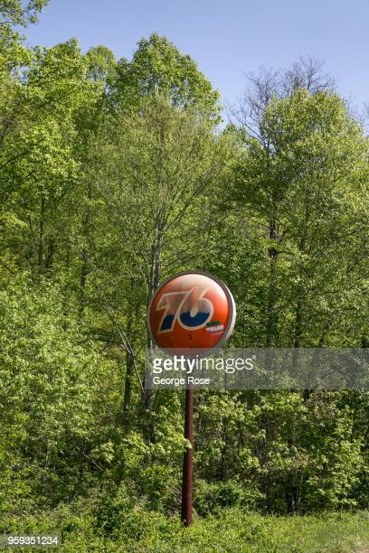 A distinctive Union Oil 76 orange ball logo stands in a lush green forest where a gas staton once stood on May 11 2018 near Asheville North Carolina...