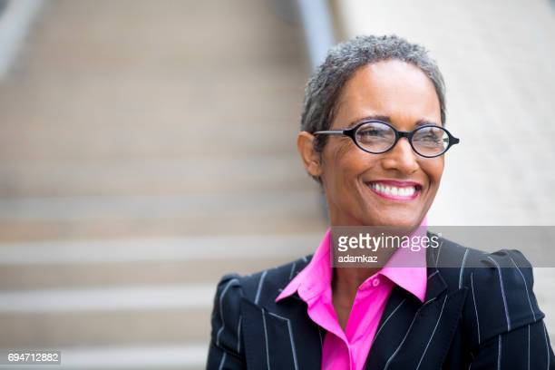 distinguished senior african american businesswoman - college professor stock photos and pictures