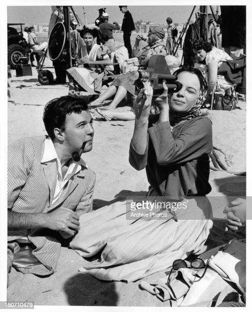 Distinguished young London and Broadway director Peter Hall enjoying the California sunshine with Leslie Caron on location for the film 'Gigi' 1958
