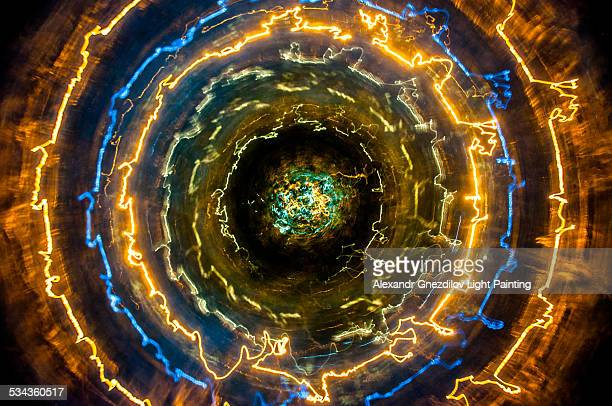 distorted concentric light circles(light painting) - core stock pictures, royalty-free photos & images