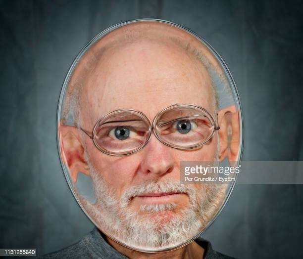Distorted Image Of Man Against Gray Background