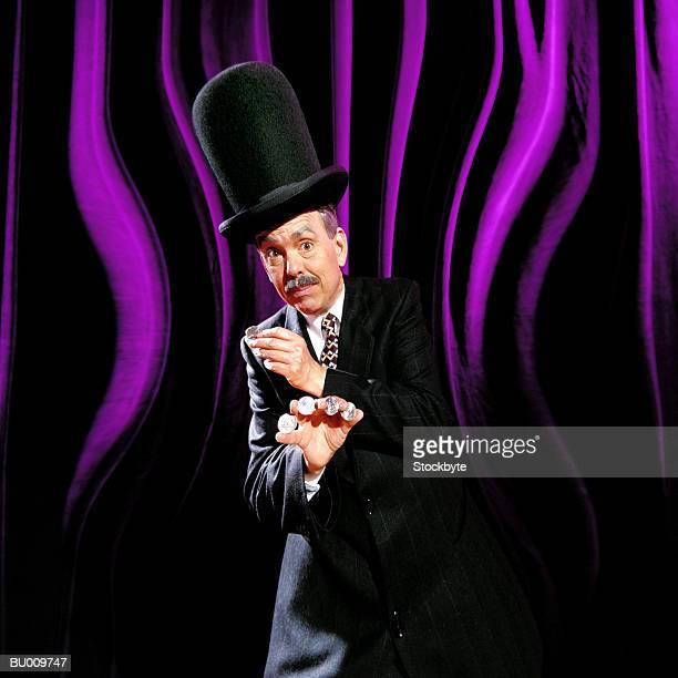distorted magician with coins in hand - zaubertrick stock-fotos und bilder
