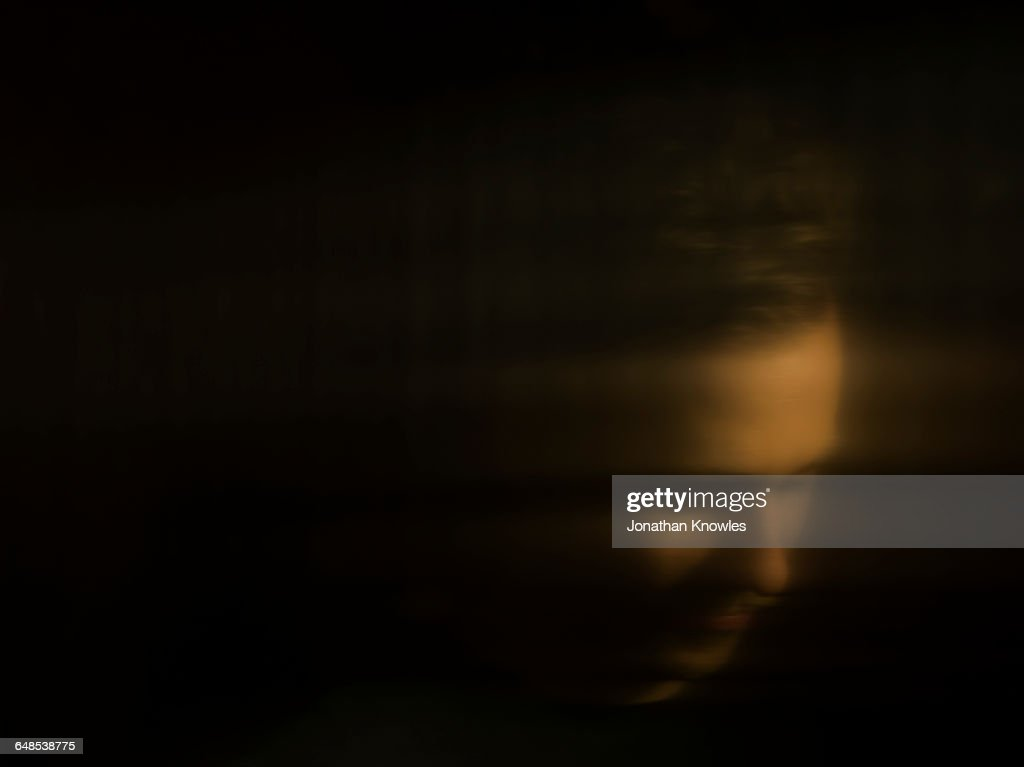 Distorted portrait of a male, reflection : Stock Photo
